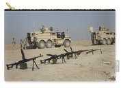 Firearms Sit Ready On A Firing Range Carry-all Pouch