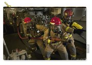 Firemen Combat A Simulated Fire Aboard Carry-all Pouch