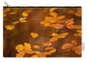 Floating On Orange Fall Leaves Carry-all Pouch