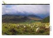 Flock Of Sheep Grazing In A Field Carry-all Pouch