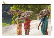 Group Of Women Carrying Firewood Near Carry-all Pouch