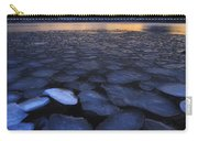 Ice Flakes Drifting Towards Carry-all Pouch by Arild Heitmann