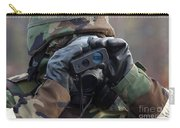 Irman Uses A Range Finder To Determine Carry-all Pouch by Stocktrek Images
