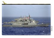Jds Atago Sails In Formation With U.s Carry-all Pouch