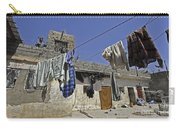 Laundry Hangs In The Courtyard Carry-all Pouch by Stocktrek Images