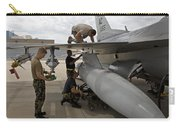 Maintenance Crew Works On Replacing Carry-all Pouch