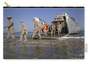 Marines Disembark From A Landing Craft Carry-all Pouch