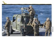 Marines Provide Security Aboard Carry-all Pouch