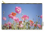 Pink Flowers Against Blue Sky Carry-all Pouch