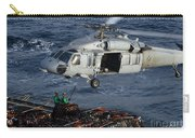 Sailors Attach Pallets Of Supplies Carry-all Pouch