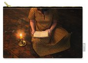Schoolgirl Sitting On Wood Floor Reading By Candlelight Carry-all Pouch
