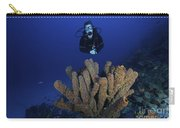 Scuba Diver Swims Underwater Amongst Carry-all Pouch