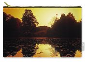 Silhouetted Home And Trees Near Water Carry-all Pouch