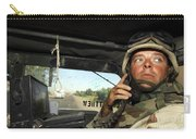 Soldier Monitors The Progress Of A 67 Carry-all Pouch