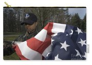 Soldier Unfurls A New Flag For Posting Carry-all Pouch by Stocktrek Images