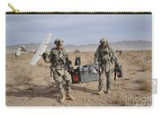 Soldiers Carry An Rq-11 Raven Unmanned Carry-all Pouch