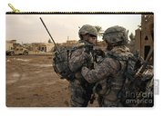 Soldiers Help One Another Carry-all Pouch by Stocktrek Images