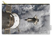 Space Shuttle Atlantis And The Docked Carry-all Pouch
