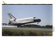 Space Shuttle Atlantis Touches Carry-all Pouch