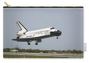 Space Shuttle Discovery Approaches Carry-all Pouch