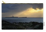 storm light - A morning light iluminates lighthouse through clouds in an amazing landscape Carry-all Pouch