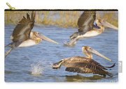 Three Pelicans Taking Off Carry-all Pouch