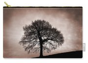 Tree Against A Stormy Sky Carry-all Pouch