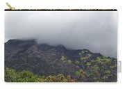 Trees And Leaves At The Base Of A Mountain With Clouds And Mist Covering The Top Carry-all Pouch