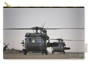 Two Uh-60 Black Hawks Taxi Carry-all Pouch by Terry Moore