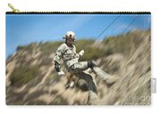 U.s. Air Force Airman Practices Carry-all Pouch