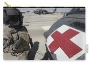 U.s. Army Crew Chief Inspects Carry-all Pouch