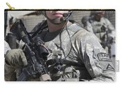 U.s. Army Soldier Conducts A Combat Carry-all Pouch
