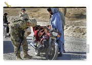U.s. Army Soldier Conducts Vehicle Carry-all Pouch