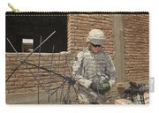 U.s. Army Soldier Configures Carry-all Pouch