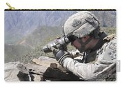 U.s. Army Soldier Monitors An Afghan Carry-all Pouch