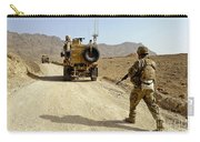 U.s. Army Soldier Moves To His Mrap Carry-all Pouch