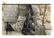 U.s. Army Soldier Performs A Radio Carry-all Pouch by Stocktrek Images