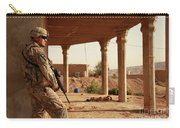U.s. Army Soldier Pulls Security Carry-all Pouch