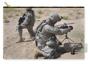 U.s. Army Soldier Sets Up A Satellite Carry-all Pouch