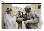 U.s. Army Soldier Shakes Hands With An Carry-all Pouch
