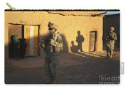 U.s. Army Soldiers Conduct A Dismounted Carry-all Pouch