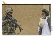 U.s. Army Specialist Talks To An Afghan Carry-all Pouch