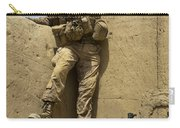 U.s. Marine Climbs Down From An Carry-all Pouch
