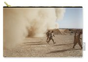 U.s. Marines Walk Away From A Dust Carry-all Pouch