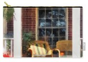 Wicker Chair With Striped Pillow Carry-all Pouch