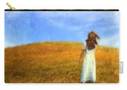 Woman In Field Looking Up At An Airplane Carry-all Pouch
