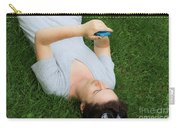 Woman Using Her Iphone Carry-all Pouch