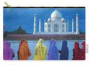 Women In Colorful Saris In Front Of The Carry-all Pouch