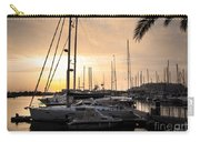 Yachts At Sunset Carry-all Pouch by Carlos Caetano