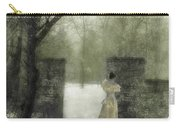 Young Lady By Stone Pillar In Snow Carry-all Pouch